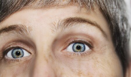 Photo for A beautiful insightful look eye. Close up shot. The eye of an elderly woman. - Royalty Free Image