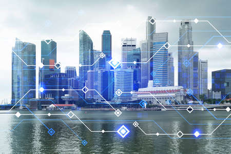 Foto de Technology hologram over panorama city view of Singapore. The largest tech hub in Asia. The concept of developing coding and high-tech science. Double exposure. - Imagen libre de derechos