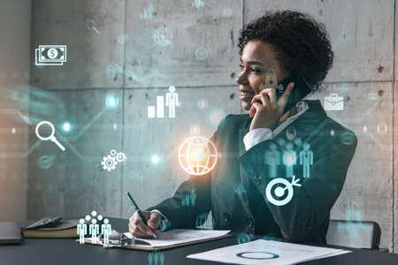 Photo pour Businesswoman speaks phone andbusiness theme hologram. Double exposure. - image libre de droit