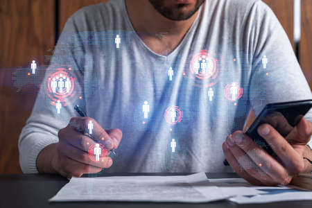 Double exposure of man signing contract with phone and world map network hologram. Concept of international business.