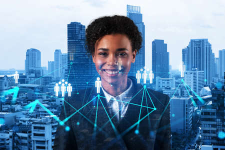 Photo pour Smiling black woman HR director at international company is thinking about recruitment of highly qualified specialists. Women in business concept. Social media hologram icons over Bangkok. - image libre de droit