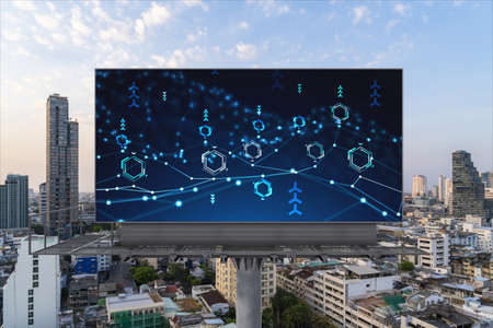 Foto de Glowing hologram of technological process on billboard, aerial panoramic cityscape of Bangkok at sunset. The largest innovative hub of tech services in Southeast Asia. - Imagen libre de derechos