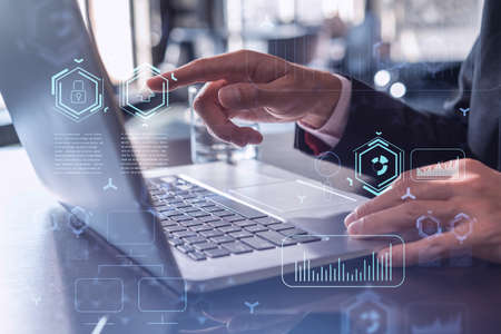 Photo pour Hands typing the keyboard to create innovative software to change the world and provide a completely new service. Close up shot. Hologram tech graphs. Concept of Dev team. Formal wear. - image libre de droit