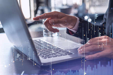 Photo pour Hands typing the keyboard to research stock market to proceed right investment solutions. Internet trading and wealth management concept. Formal wear. Hologram Forex chart over close up shot. - image libre de droit