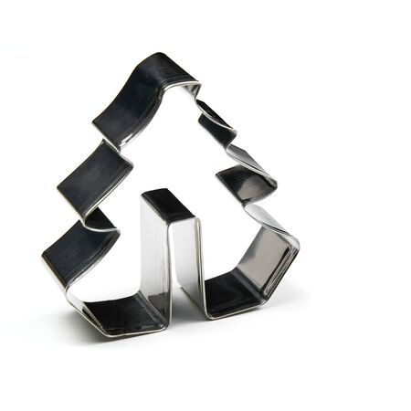 Photo pour gingerbread cookie cutter. stainless steel molds for baking christmas cookies. Christmas tree isolated on white with copy space - image libre de droit