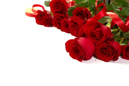 Photo for beautiful bouquet of red roses lies on a white background. Young red roses are very fragrant. Dutch flowers are popular all over the world and delight millions of women around the world - Royalty Free Image