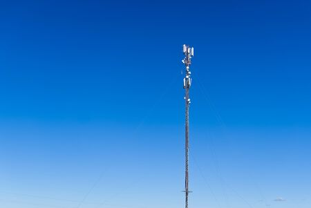 Photo pour Telecommunication tower of 4G and 5G cellular. Cell Site Base Station. Wireless Communication Antenna Transmitter. Telecommunication tower with antennas against blue sky background. - image libre de droit