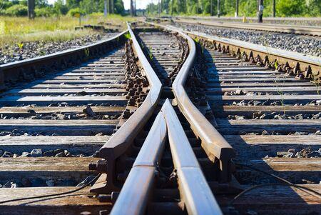 Railroad closeup. Railway tracks, Iron rusty train railway detail over dark stones.