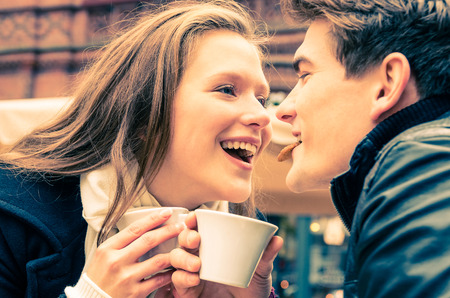 Young Couple lovely enjoying a cup of Coffee