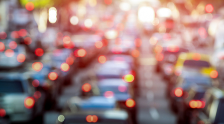 Foto de Rush hour with defocused cars and generic vehicles - Traffic jam in Los Angeles downtown - Blurred bokeh postcard of american iconic city with dark contrast sunshine filter - Transportation concept - Imagen libre de derechos