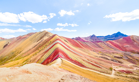 Photo pour Panoramic view of Rainbow Mountain at Vinicunca mount in Peru - Travel and wanderlust concept exploring world nature wonders - Vivid multicolor filter with bright enhanced color tones - image libre de droit
