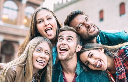 Photo for Best friends taking selfie at city tour trip - Happy friendship concept with millennial people having fun together - Everyday life concept of new generation representatives enjoying carefree lifestyle - Royalty Free Image