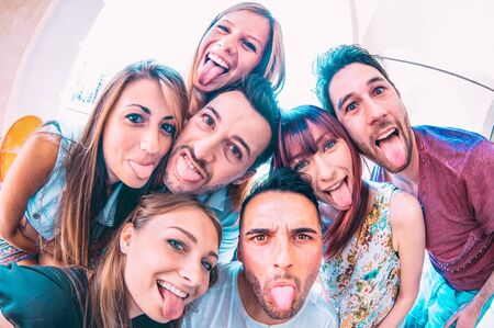 Photo for Best friends taking crazy selfie at city tour trip - Happy friendship with millennial students having fun together - Everyday life concept of new generation on carefree lifestyle at college campus - Royalty Free Image