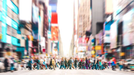 Photo pour Defocused background of people walking on zebra crossing on 7th avenue in Manhattan - Crowded streets of New York City during rush hour in urban area - Vivid sunset filter with soft sharp focus - image libre de droit