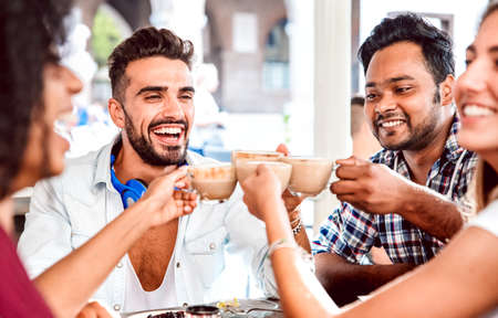 Photo for People group drinking latte at coffee bar restaurant - Happy friends talking and having fun together at cafeteria dehors - Life style concept with happy men and women at cafe - Focus on left guy - Royalty Free Image