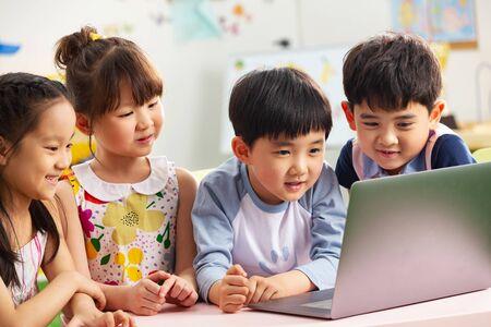 Photo for The kindergarten children watch video - Royalty Free Image