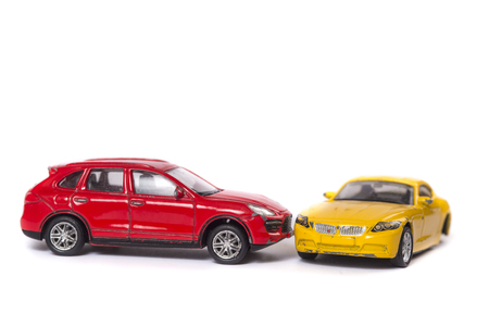 Photo for Car crash between red car and yellow car isolated on white - Royalty Free Image