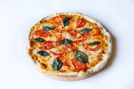 Photo pour tasty vegetable pizza on desk board on white background - image libre de droit