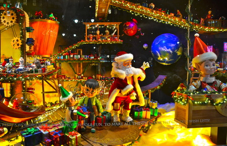 NEW YORK - DECEMBER 12, 2014: Spectators view holiday window display at MACY