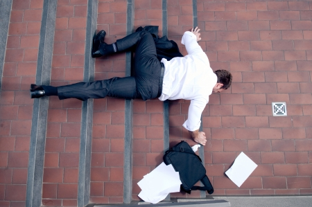 Businessman falling down the stairs