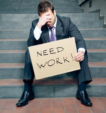 Photo for Desperate businessman looking for a job - Royalty Free Image
