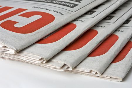 Duplicate copies of a daily newspaper. Can be used as conceptual or to indicate print media.