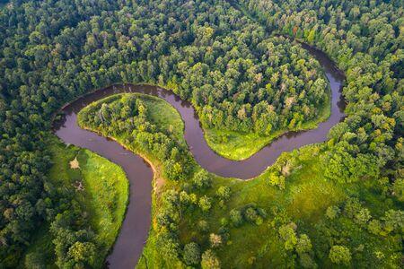Aerial shot of river West Biarezina in Naliboki forest, Belarus