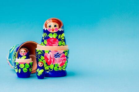 Photo pour Blue matryoshka on a blue background, Slavic souvenir. - image libre de droit