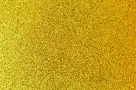 Photo for Defocused background of shining sparkles, abstract golden light. - Royalty Free Image
