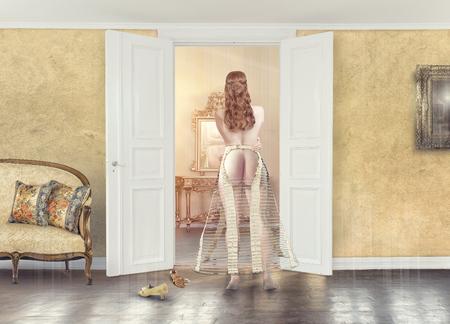 Foto de Young girl in a crinoline in front of a mirror - Imagen libre de derechos