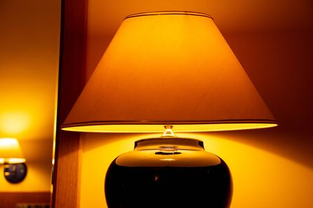 Photo for Bedside table lamp light in the room - Royalty Free Image