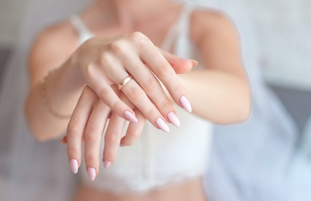Foto de Close-up Woman showing her hands with beautiful manicure.Brides hands with a nice manicure. - Imagen libre de derechos