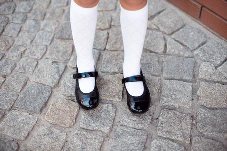 Foto de Close-up retro style image of school girls feet in uniform - Imagen libre de derechos