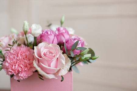 Photo pour Stylish wedding bouquet bride of pink roses, white carnation and green flowers and greens with ribbons lying on pastel table. - image libre de droit