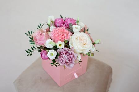 Foto de Beautiful spring bouquet with tender flowers in box. - Imagen libre de derechos