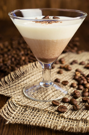 chocolate and vanilla panna cotta with coffee beans
