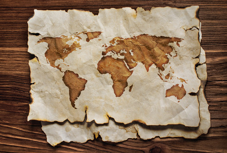 Old map on parchment on the wooden background