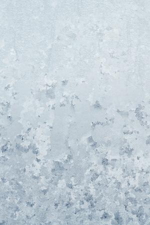 Winter frosty patterns on the frozen ice window