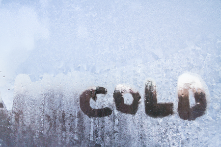 The inscription is cold on a frozen window with patterns