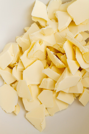 Photo pour Pieces of butter are in a bowl for mixing in the preparation of cookies - image libre de droit
