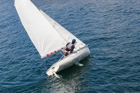 Photo for Sailing. Yacht with white sail on the waves in the sea - Royalty Free Image