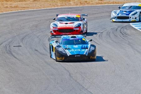 JEREZ DE LA FRONTERA, SPAIN - OCT 16: Ferran Monje(4) followed by Francesc Gutierrez(42) and Pedro Lopes(44) races on Iber GT championship on October 16 , 2011, in Jerez de la Frontera , Spain