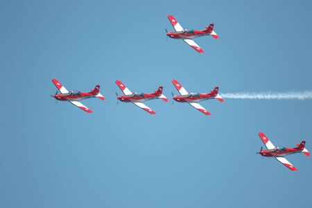 Photo for TORRE DEL MAR, MALAGA, SPAIN-JUL 28: Aircraft of the Swiss air force PC-7 Team  taking part in a exhibition on the 3rd airshow of Torre del Mar on July 28, 2018, in Torre del Mar, Malaga, Spain - Royalty Free Image