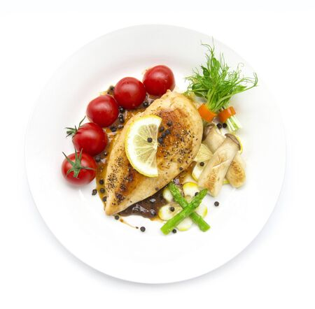 Photo pour Grill Chicken breast  or chicken steak with black peppers sauce topped black peppers decorate asparagus,oyster mushroom,tomato and lemon carved style  top view isolated on white background - image libre de droit