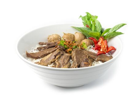 Photo for Vermicelli Noodles with Braised Stewed Beef without soup (kuay taiw nuae toon) Thai food dish decorate with vegetables style side view - Royalty Free Image