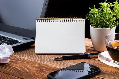 Foto de Office table with notepad, computer and coffee cup. Business creative consept. - Imagen libre de derechos