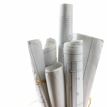 Foto de Architectural blueprints and blueprint rolls on white background - Imagen libre de derechos