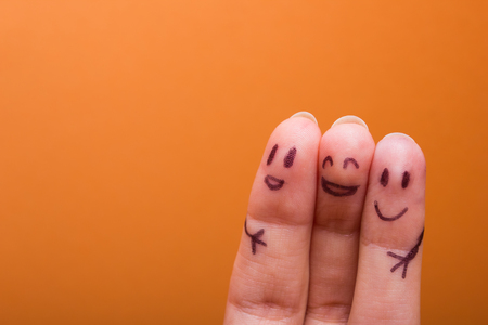 Photo pour three smiling fingers that are very happy to be friends, family concept - image libre de droit