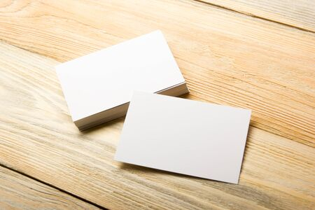 Photo for Business card blank on wooden background. Corporate Stationery, Branding Mock-up. Creative designer desk. Flat lay. Copy space for text. - Royalty Free Image