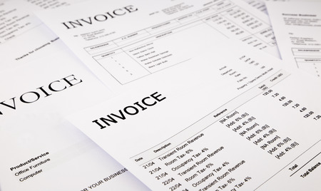close-up difference invoices and bills, document and paperwork